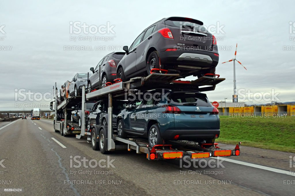 Opel and Peugeot cars on the same car transporter stock photo