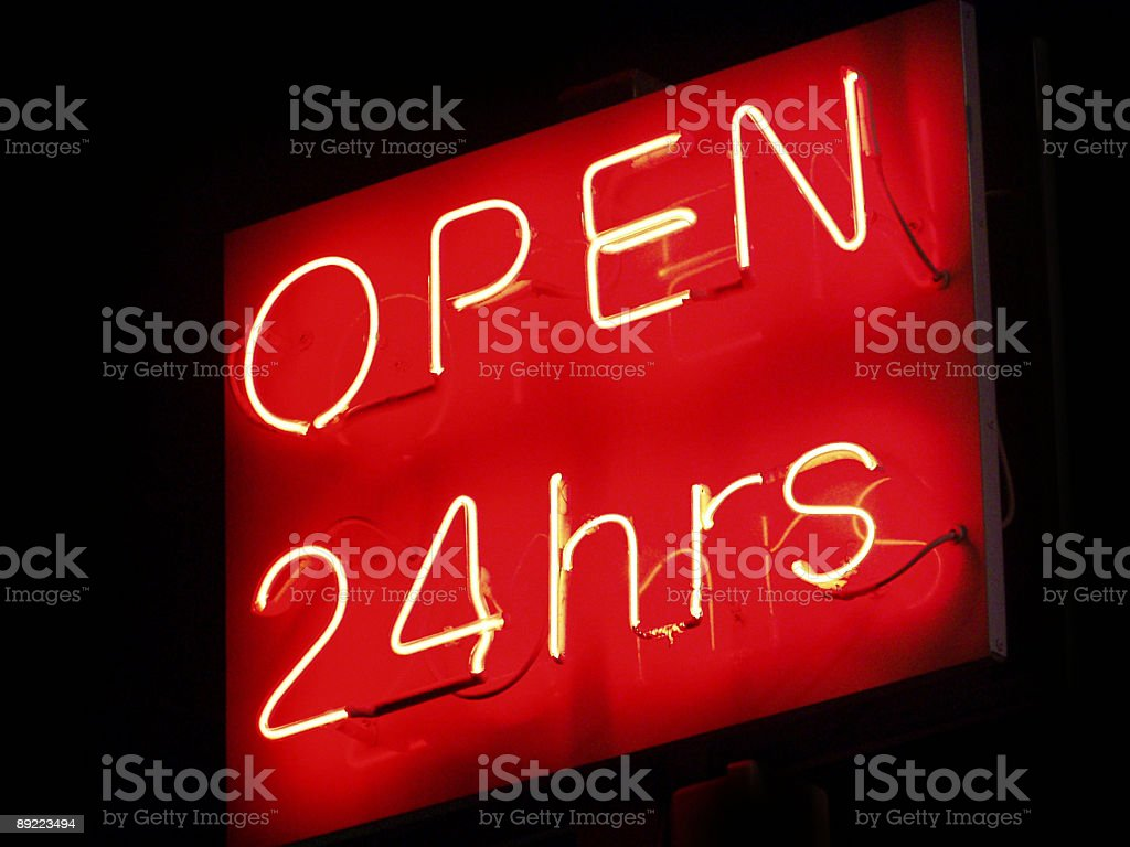Open 24 hrs neon sign stock photo
