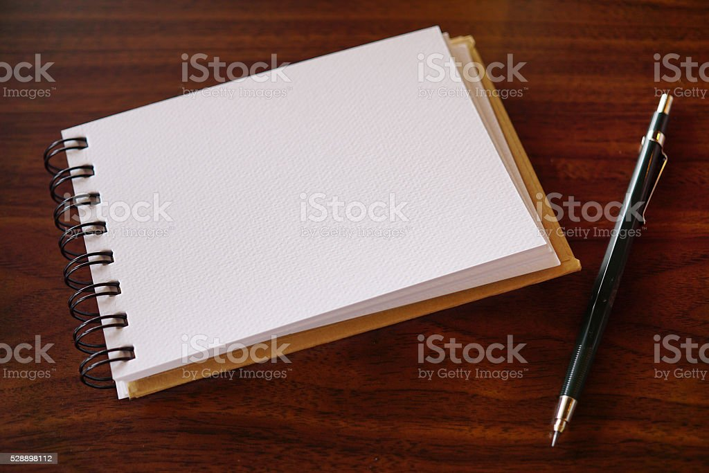 Open a blank white notebook  with pencil stock photo