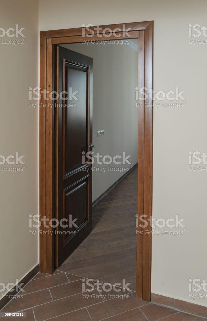 Open a door to a room. stock photo