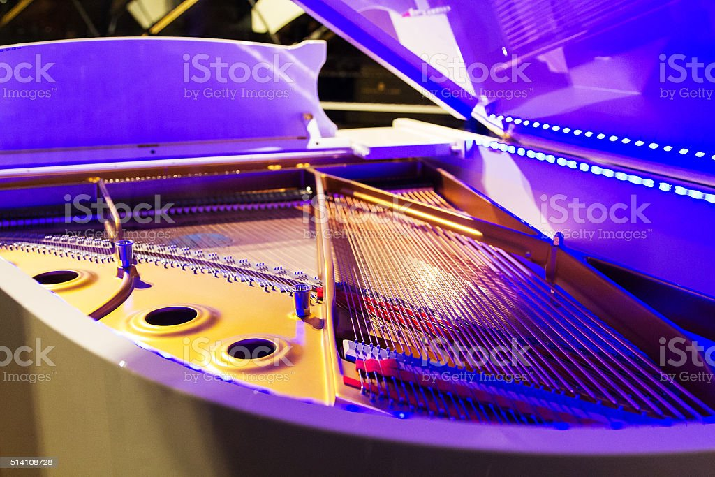 Open a piano, strings. stock photo