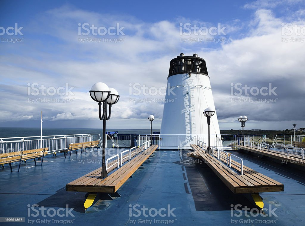 open air deck seats on a channel ferry with funnel royalty-free stock photo