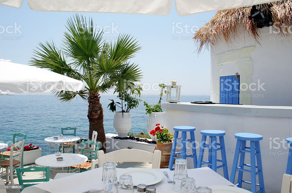 Open air restaurant by the sea in Athens, Greece royalty-free stock photo