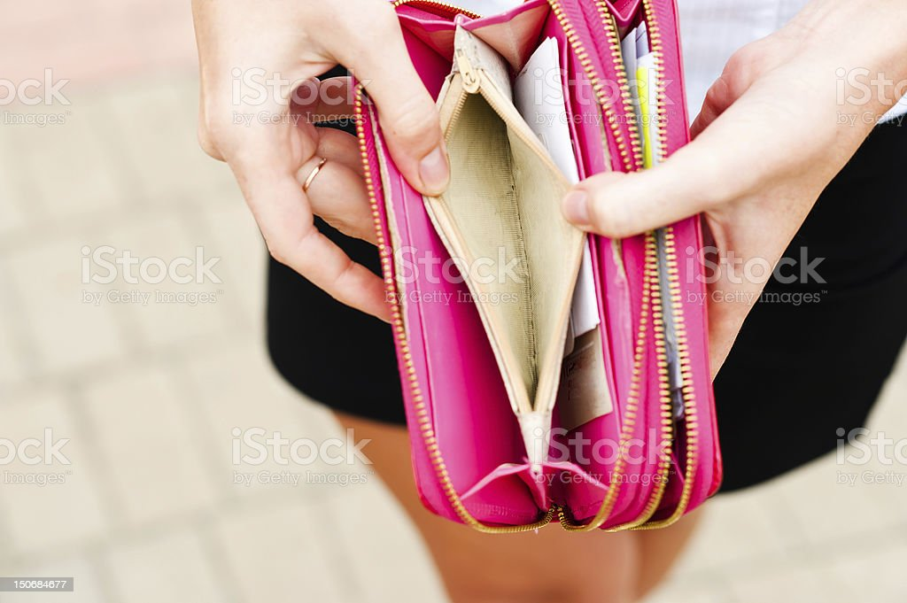 Open and empty pink women's wallet stock photo