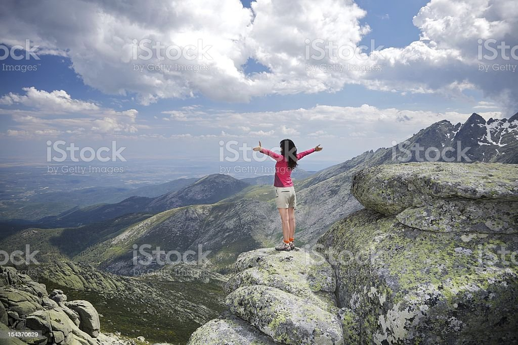 open arms cross woman at top summit mountains touch clouds stock photo