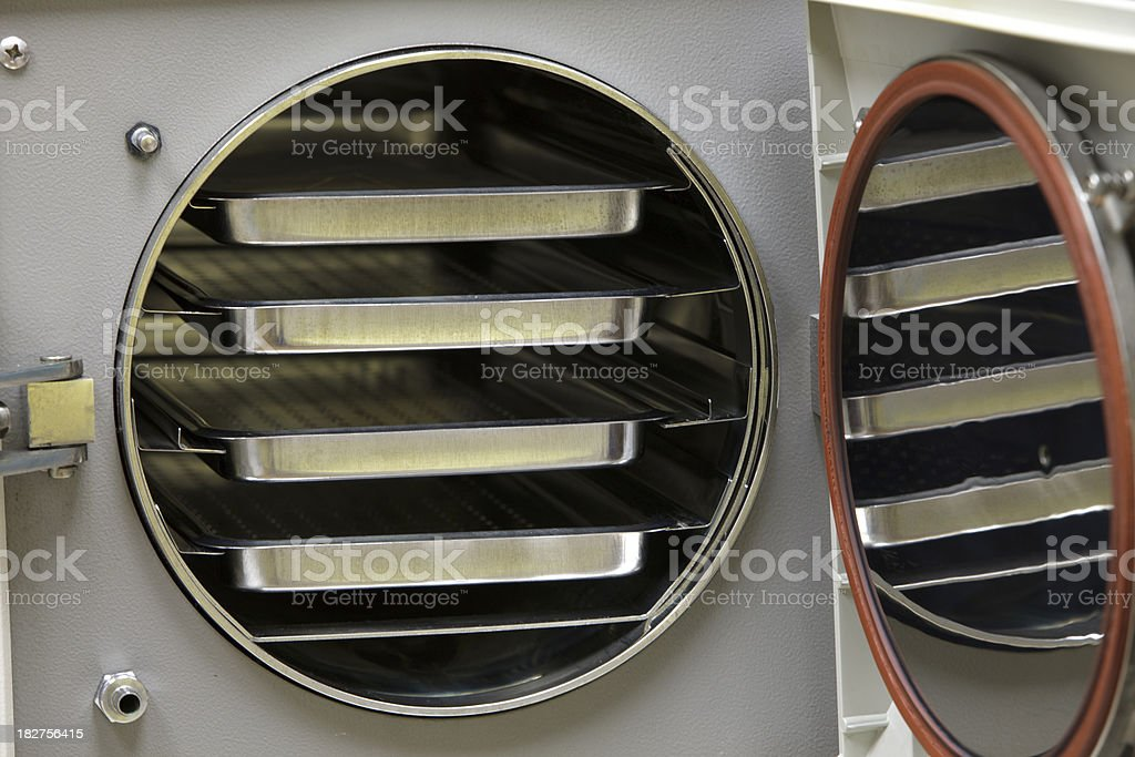 Open Autoclave With Sterilization Trays royalty-free stock photo