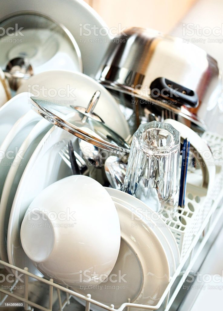 open automatic dishwasher with ready tableware stock photo