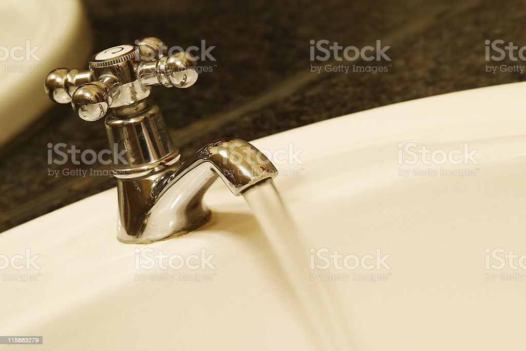Open bathroom tap and running water royalty-free stock photo