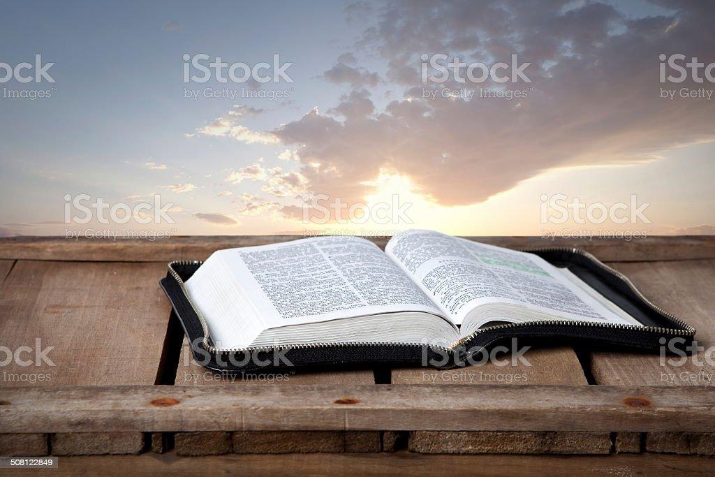 Open bible at sunset stock photo