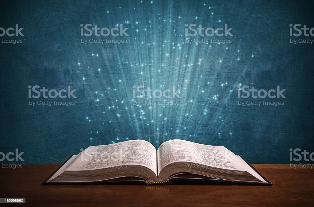Open Bible on a desk stock photo