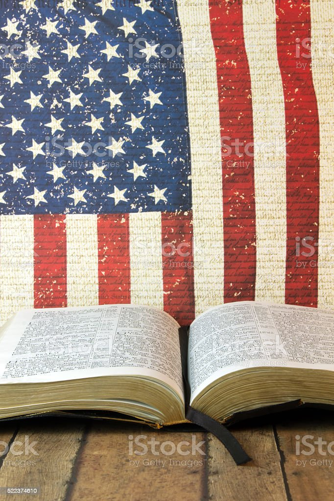 Open Bible on a Red, white and blue background stock photo