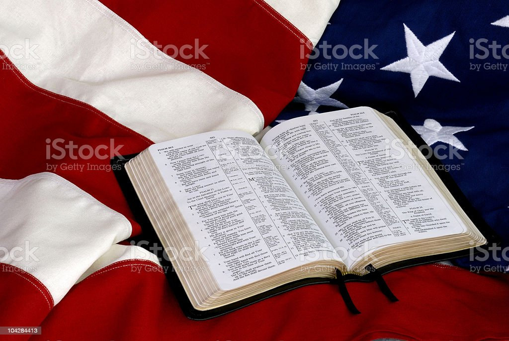 Open Bible on American Flag stock photo