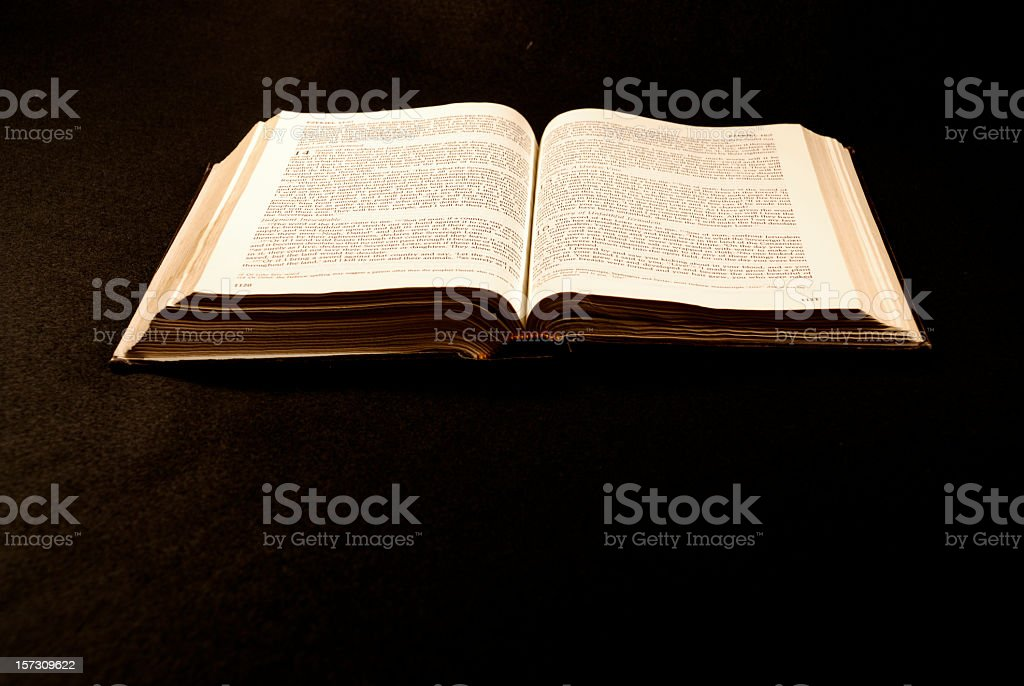 Open Bible on Black Background with Copy Space royalty-free stock photo