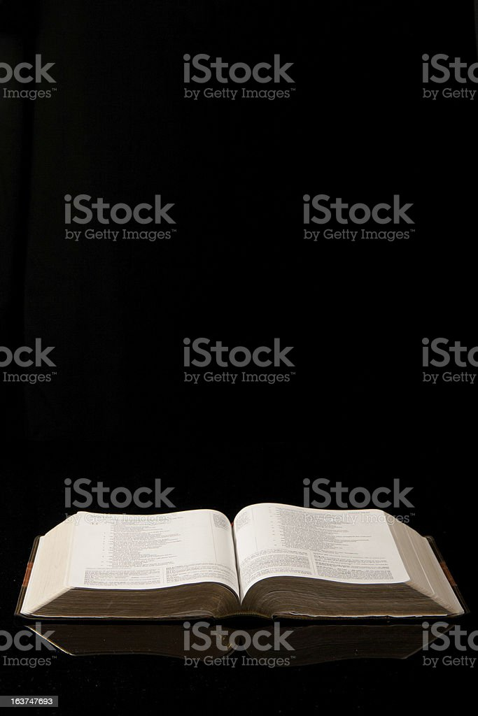 Open Bible on Black royalty-free stock photo