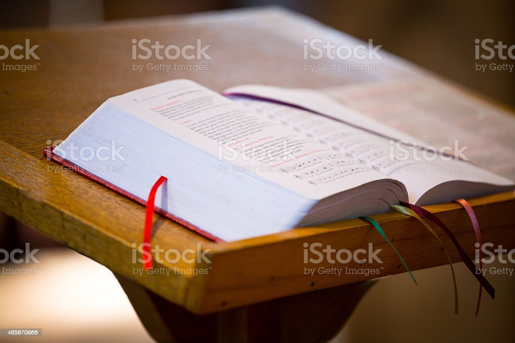 Open bible on table with bookmarks in pages stock photo