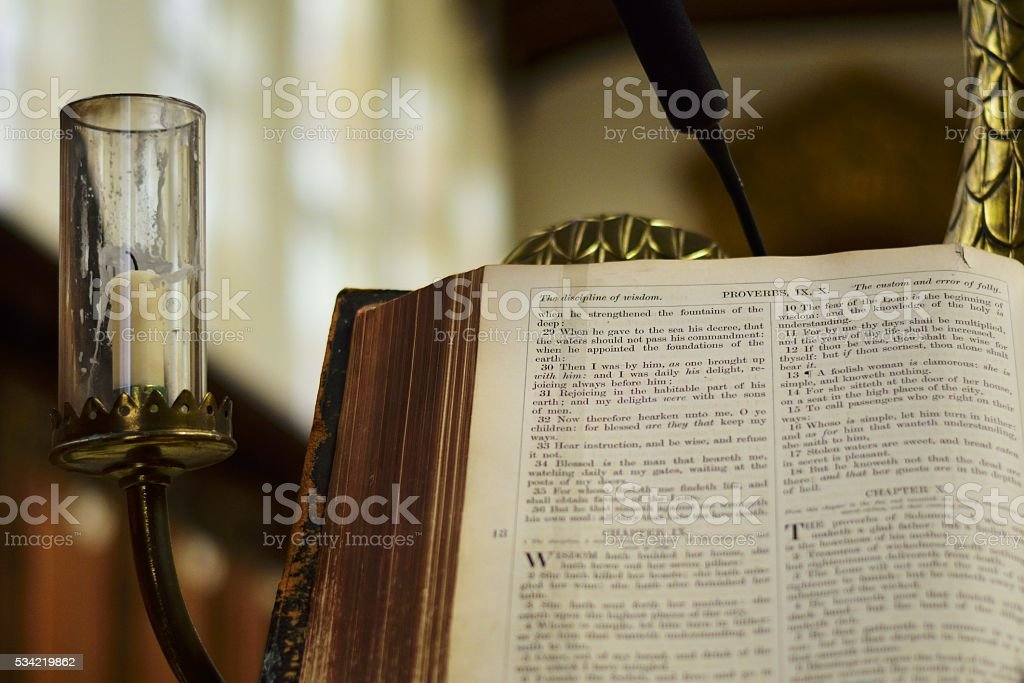 Open Bible resting on pulpit stock photo
