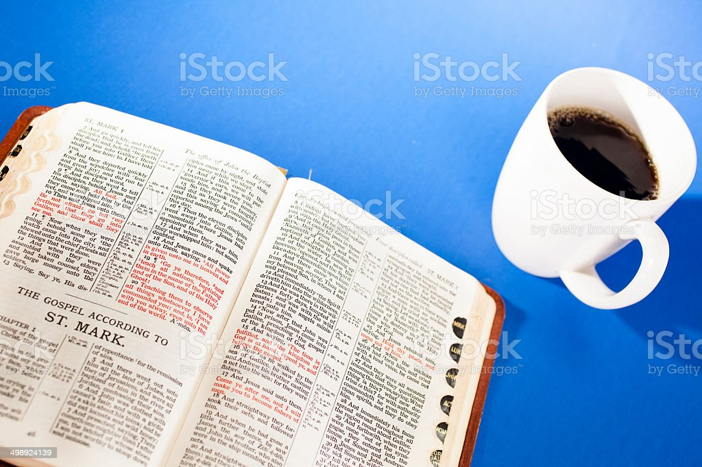Open Bible to the gospel of St. Mark. Morning coffee. royalty-free stock photo