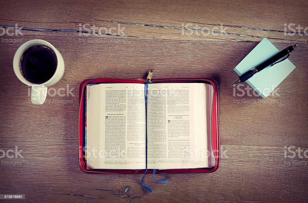 Open bible with coffee stock photo