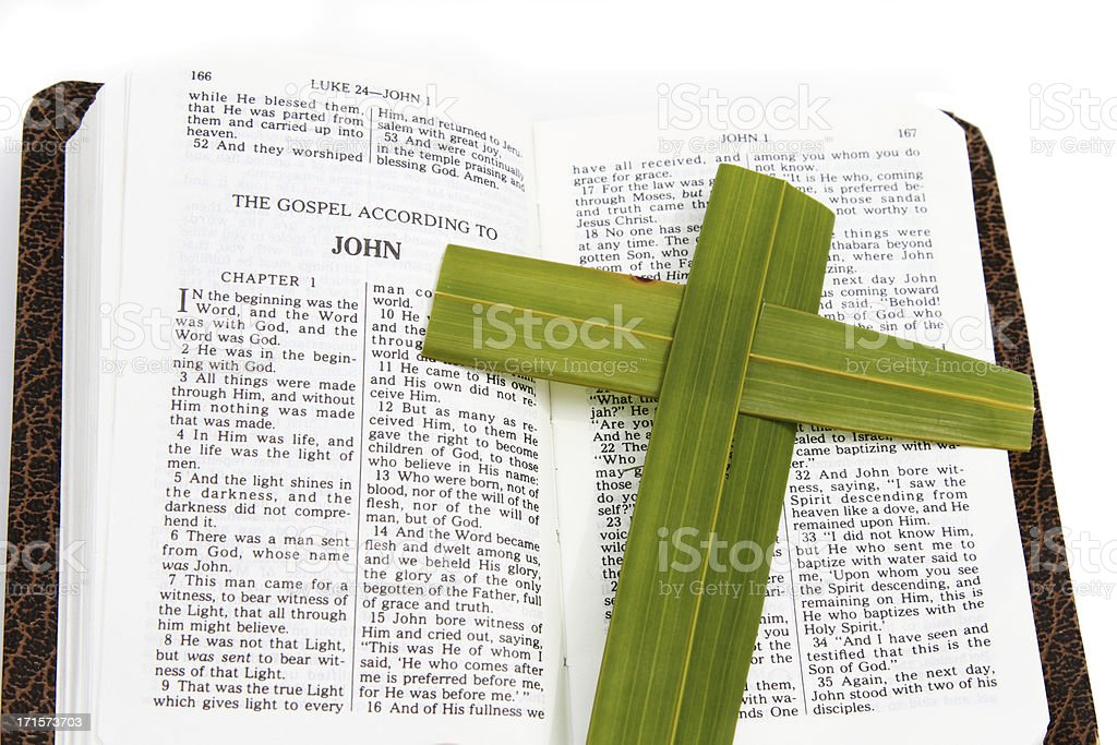 Open Bible with Palm Leaf Cross stock photo