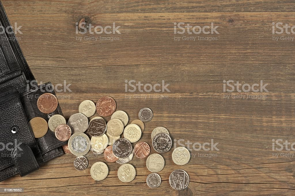 Open Black Male Black Leather Wallet With British Different Coin stock photo