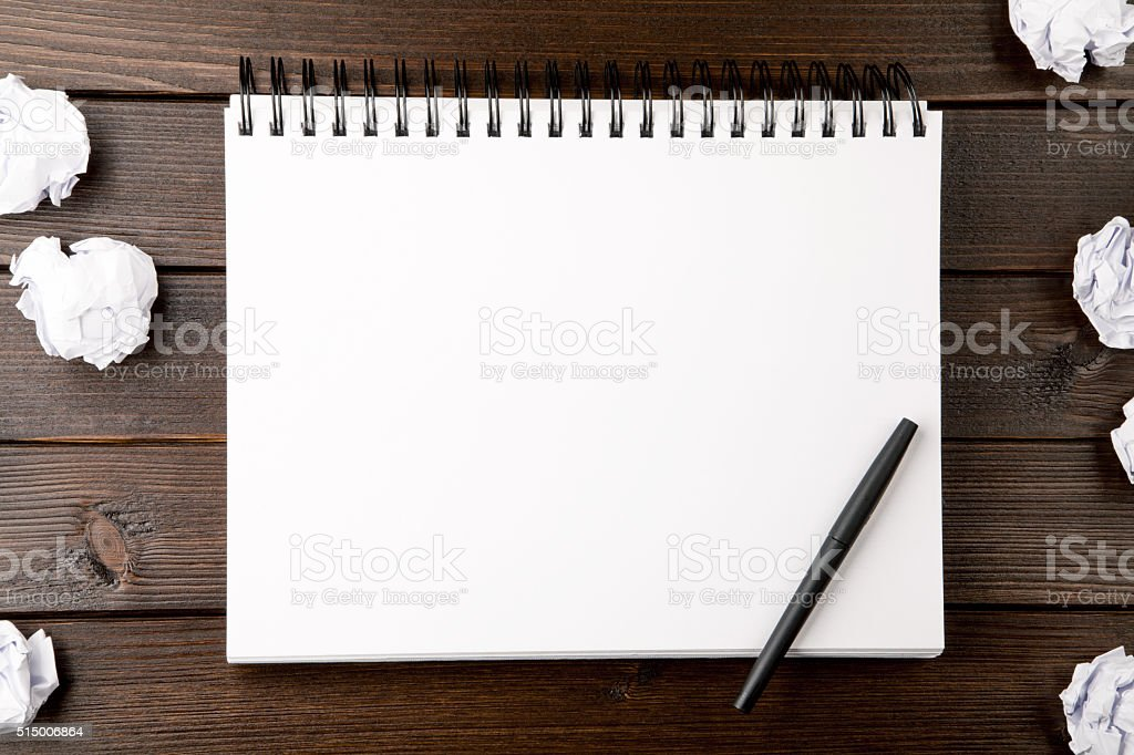 open blank notebook with crumpled paper stock photo