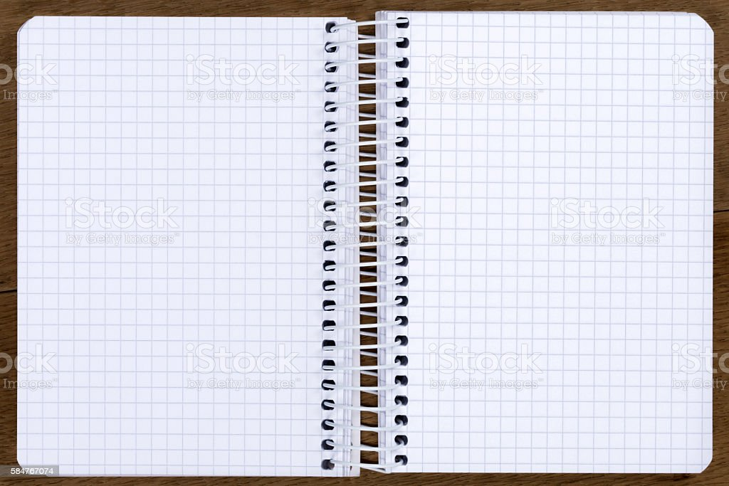 Open blank spiral bound notebook with squared paper stock photo