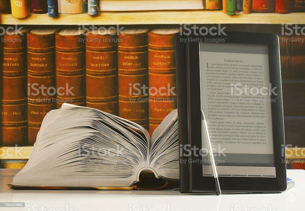 Open book and e-book reader royalty-free stock photo