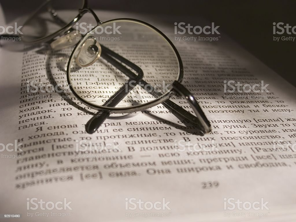 Open book and glasses royalty-free stock photo