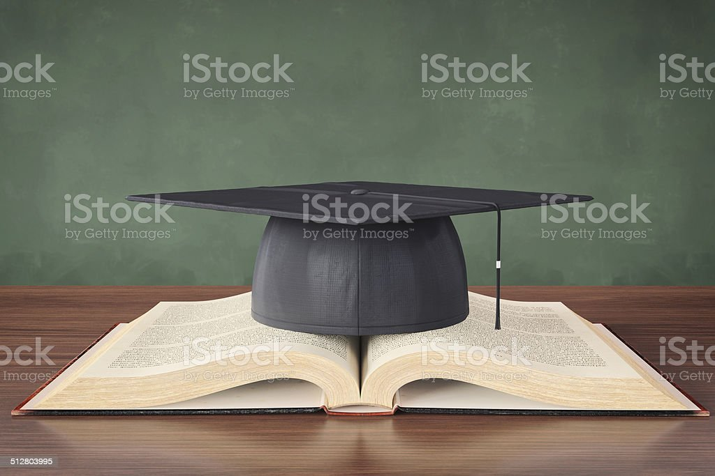 Open Book And Graduation Cap stock photo