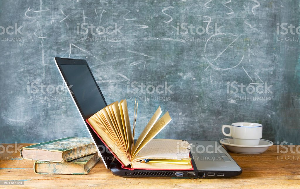 open book and laptop stock photo