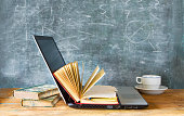 open book and laptop