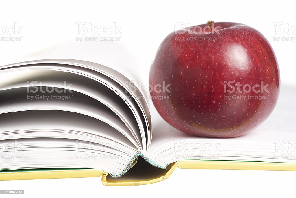 Open Book and Red Apple stock photo