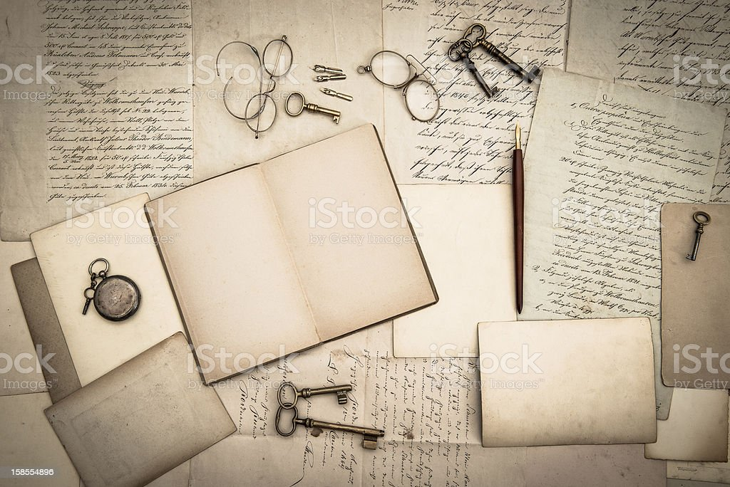 open book, antique accessories, old letters stock photo