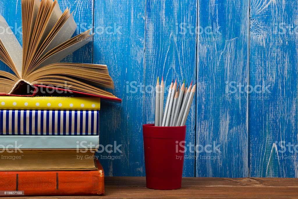 Open book, hardback books on wooden table. Back to school stock photo