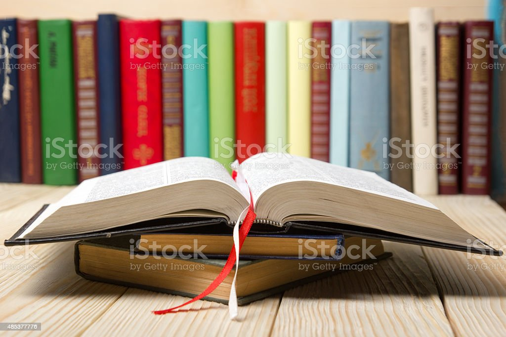 Open book, hardback books on  wooden table stock photo