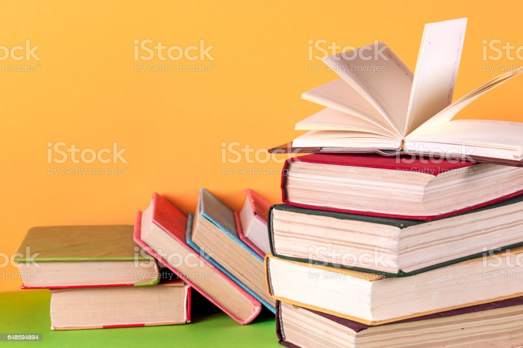 Open book, hardback bookson bright colorful background. stock photo