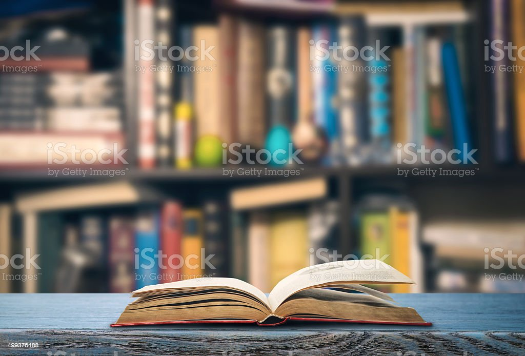 Open book in a library stock photo