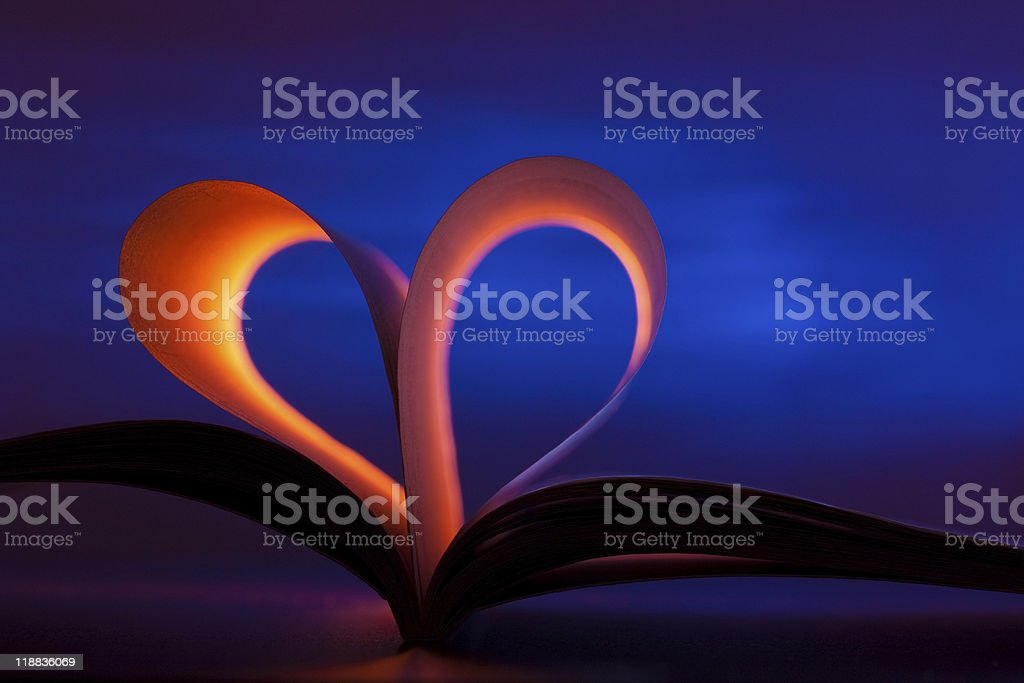 Open book in heart shape stock photo