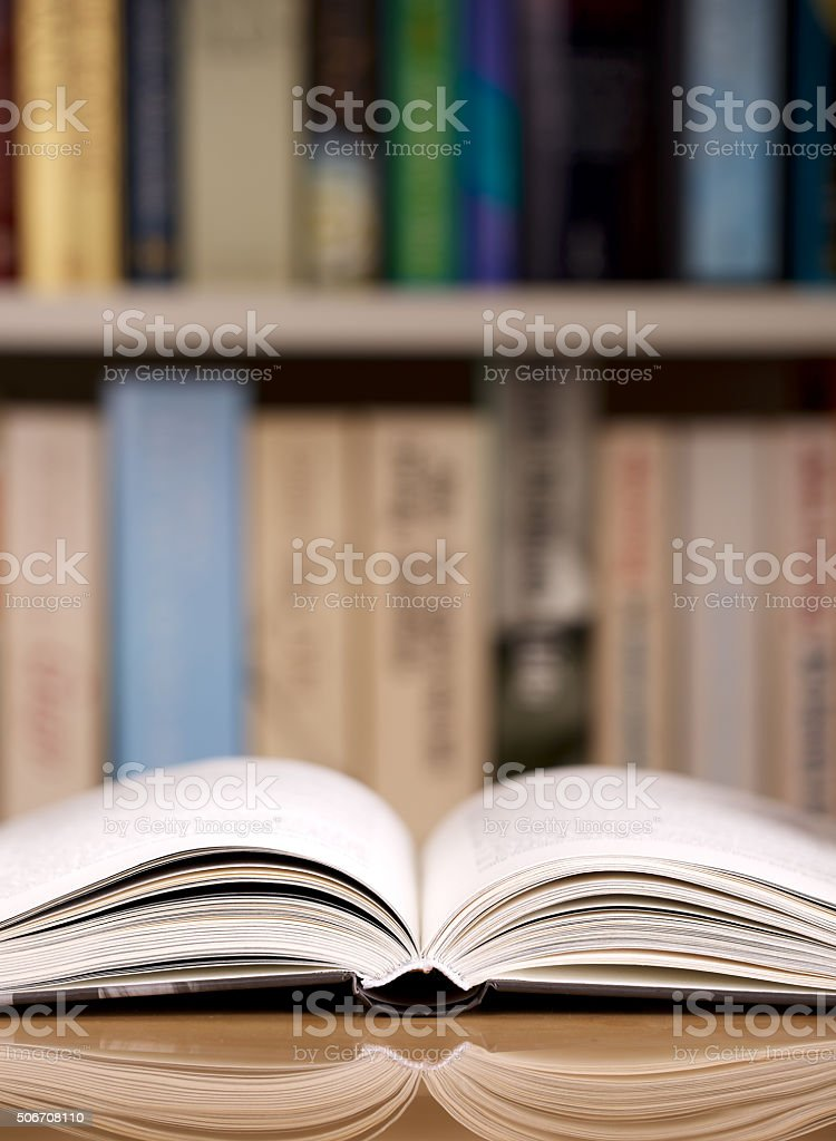 Open book in library or bookstore stock photo