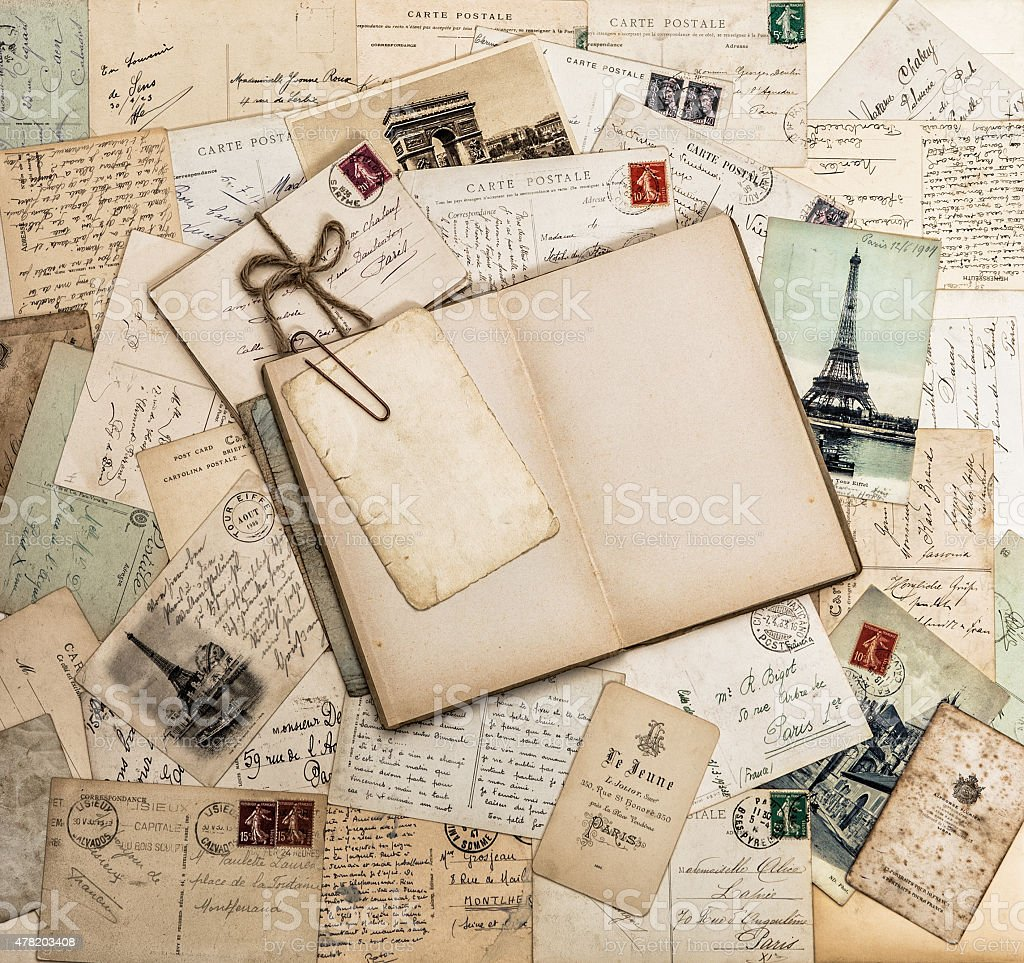 Open book, old letters and postcards. Travel scrapbook France Paris stock photo