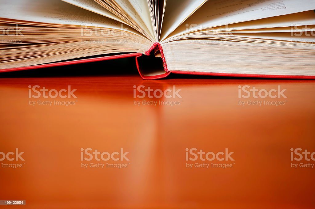 Open book on a desk (with copyspace) stock photo