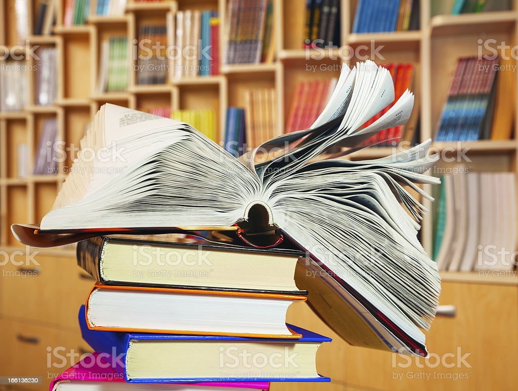 Open book on a stack of books royalty-free stock photo