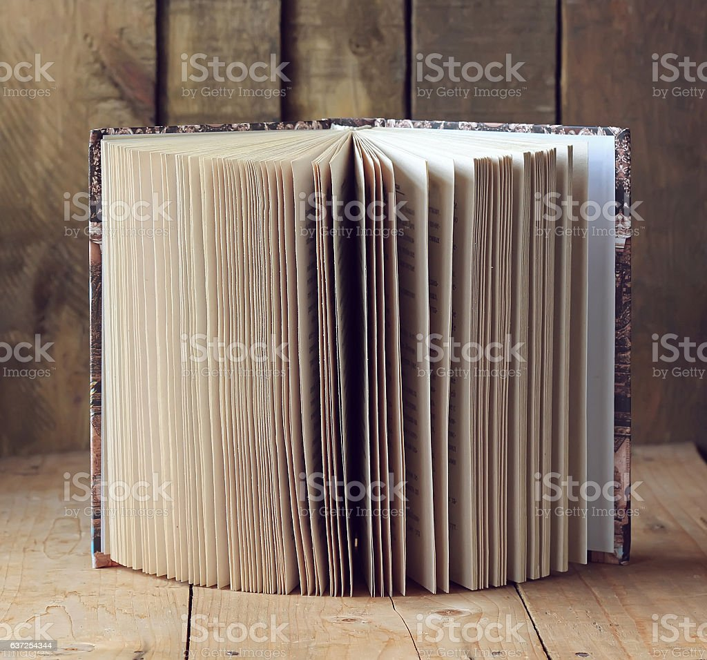 Open book on a wooden table. stock photo