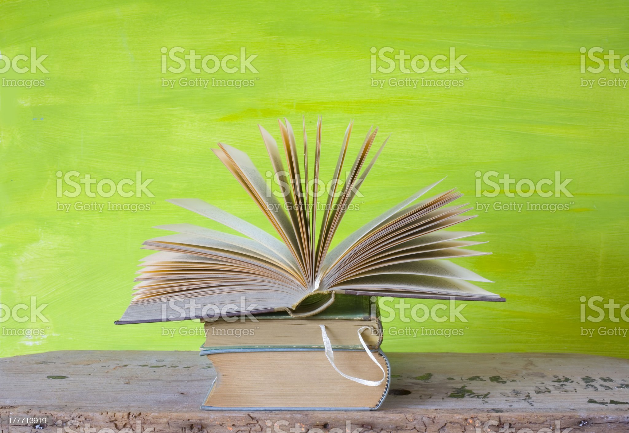 open book on green background,education concept royalty-free stock photo
