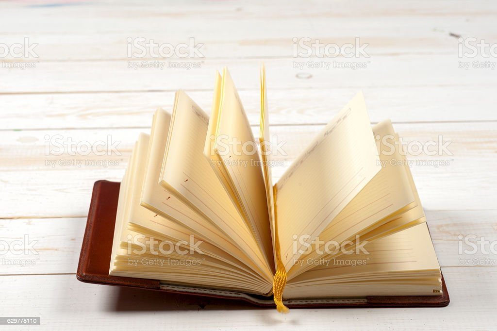 Open book on light table. Back to school. Copy space. stock photo