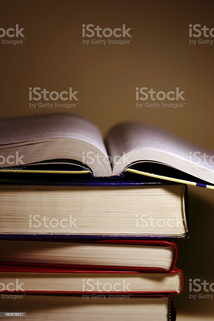 open book on pile royalty-free stock photo
