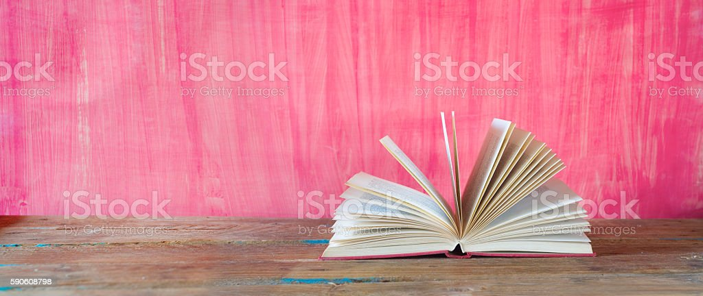 open book on red grungy background stock photo
