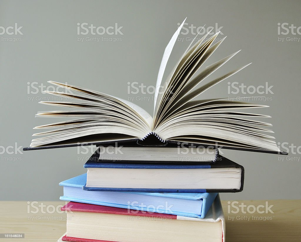 open book on stack of books royalty-free stock photo