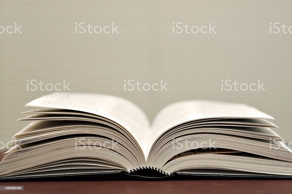 Open book on table white background royalty-free stock photo