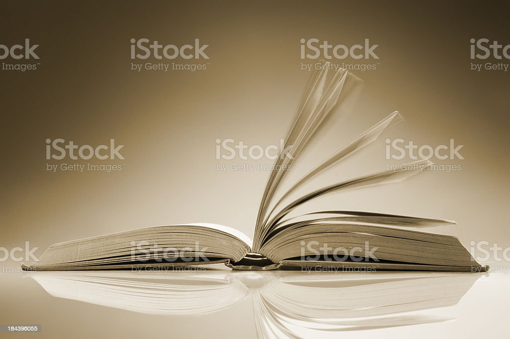 Open book on table with its pages fanned open royalty-free stock photo